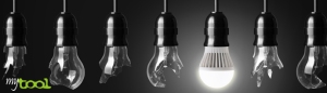 Idea concept with broken bulbs and one glowing LED bulb
